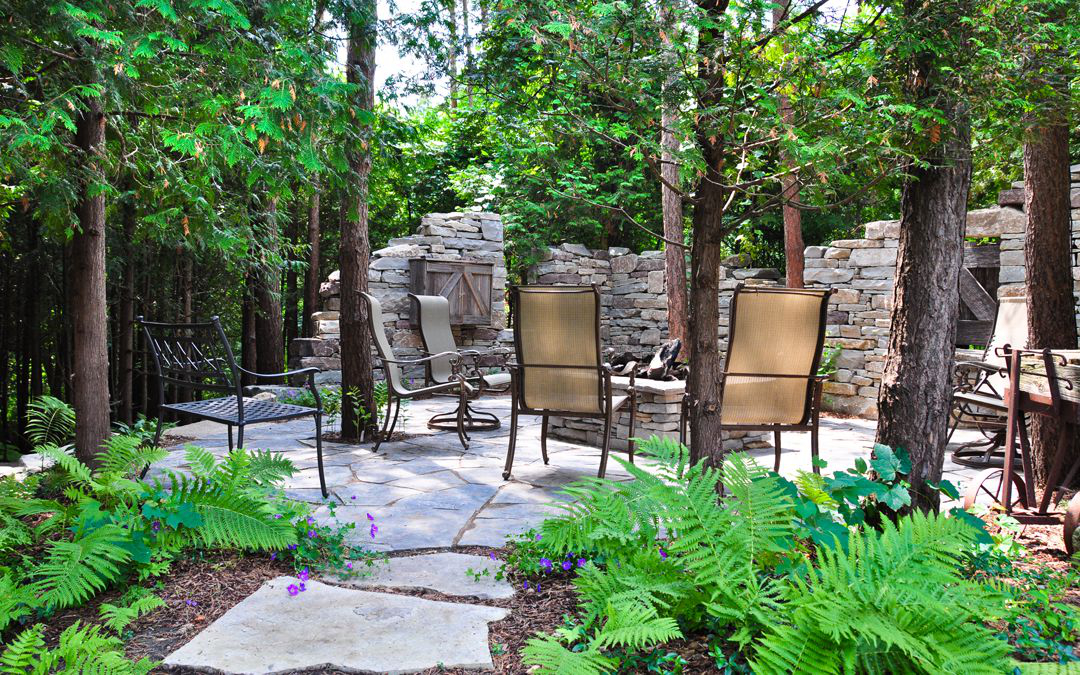 A beautiful sitting area surrounded by drystone walls resembling an antient ruin.