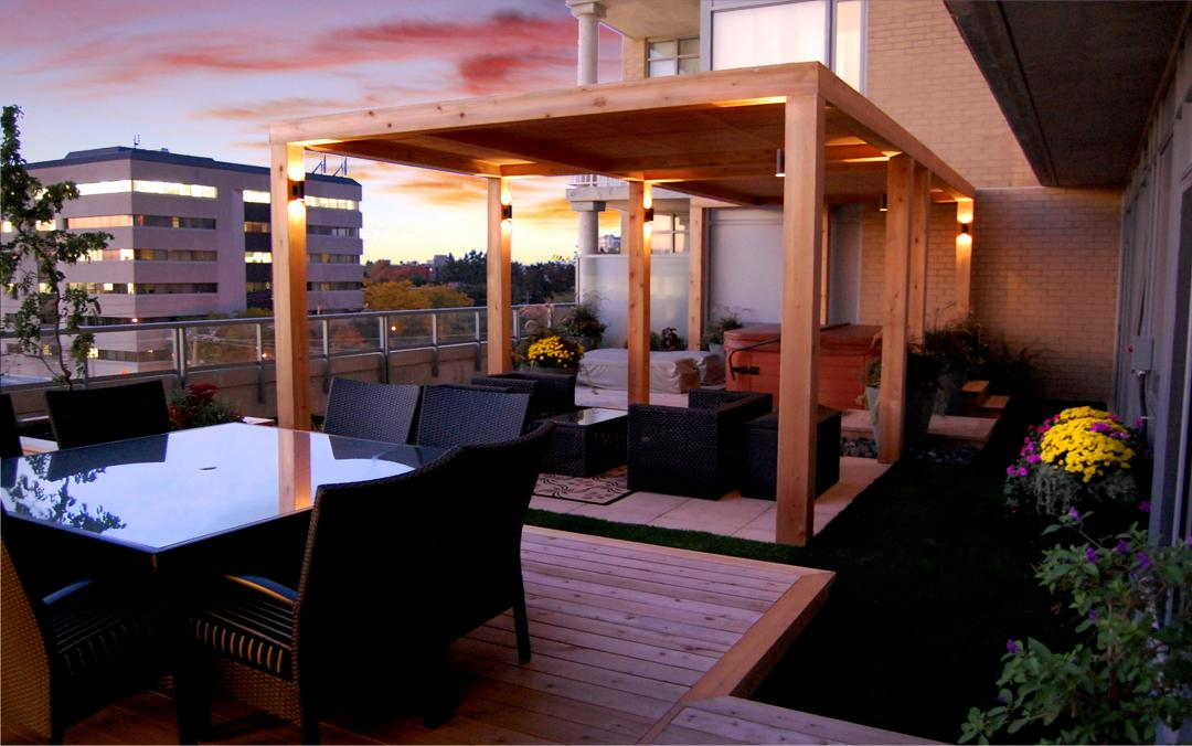 A rooftop terrace with timber patio and an outdoor sitting area.