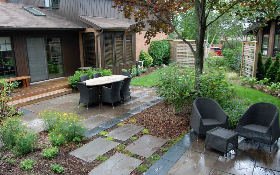A private outdoor sitting area with stone walkway and patio.