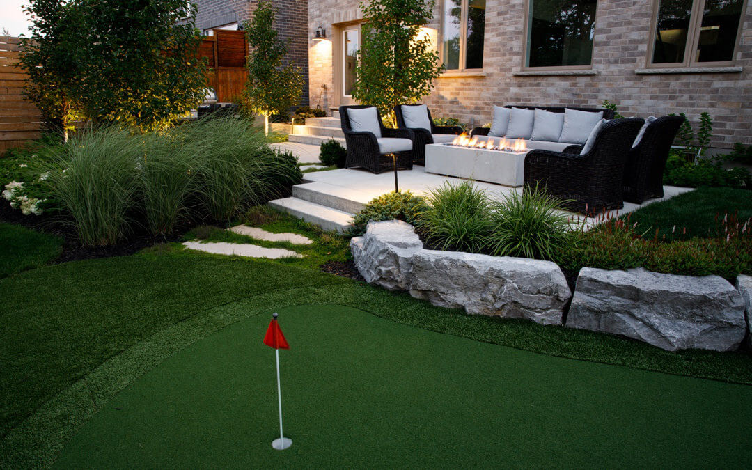 A small putting green with drystone walls and a stone patio.