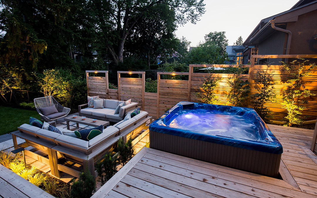 A hot tub with timber deck and an outdoor sitting area.