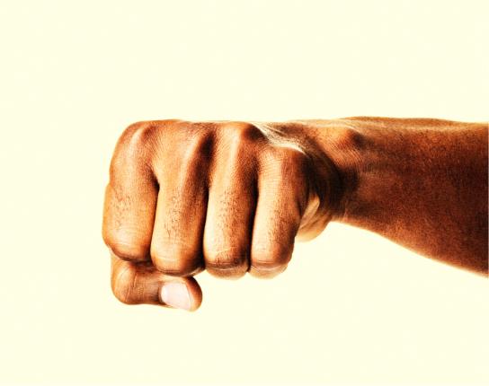 Black fist punching towards the camera.