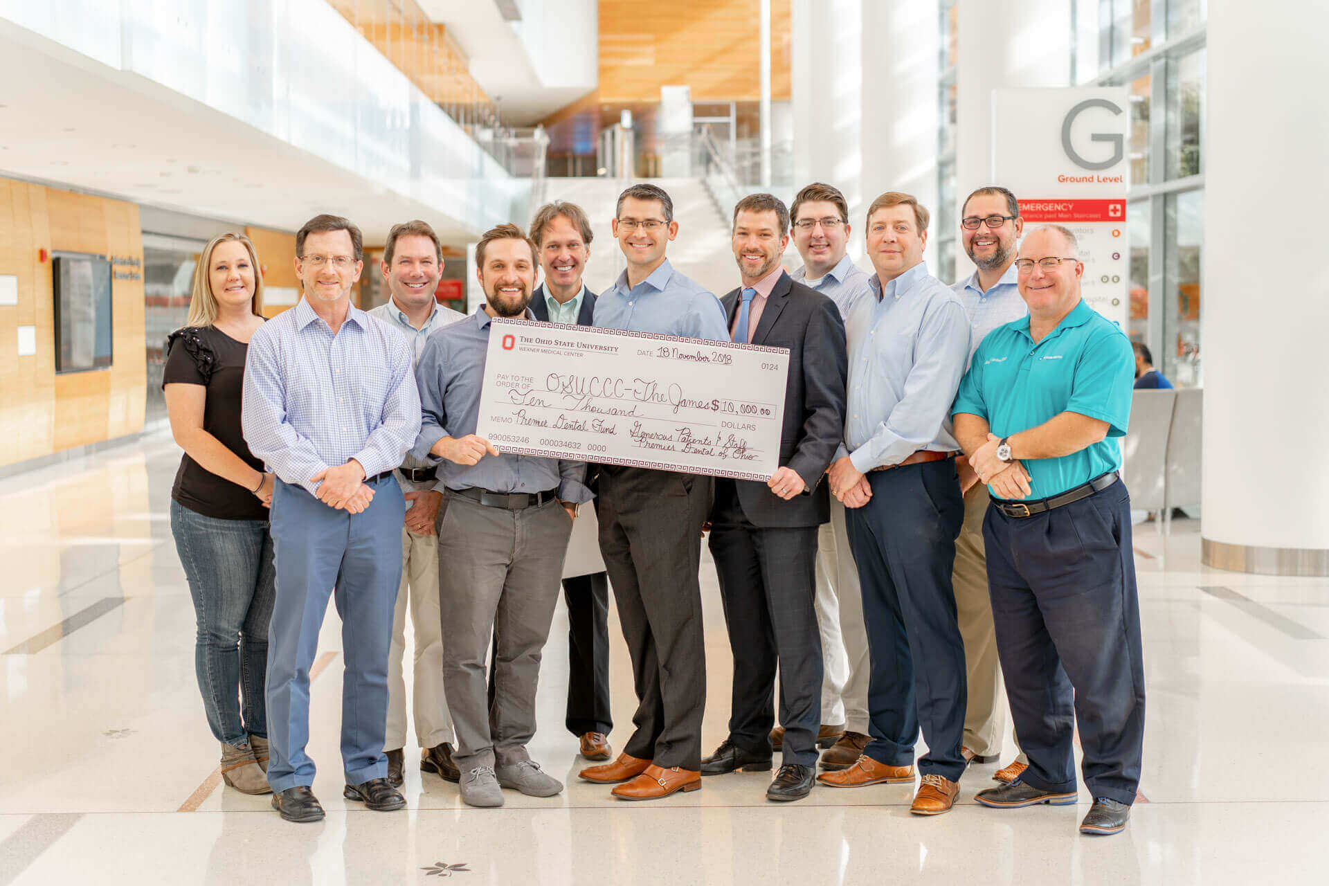 The doctors of Premier Dental of Ohio donating a large check to The Ohio State The James Cancer Hospital