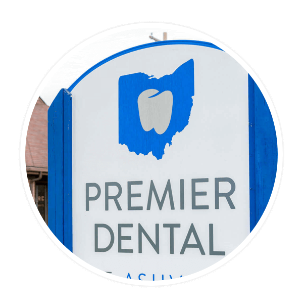 Premier Dental sign in front of an office building