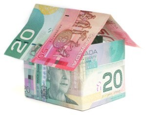 two twenty-dollar Canadian bills stacked in the shape of a house