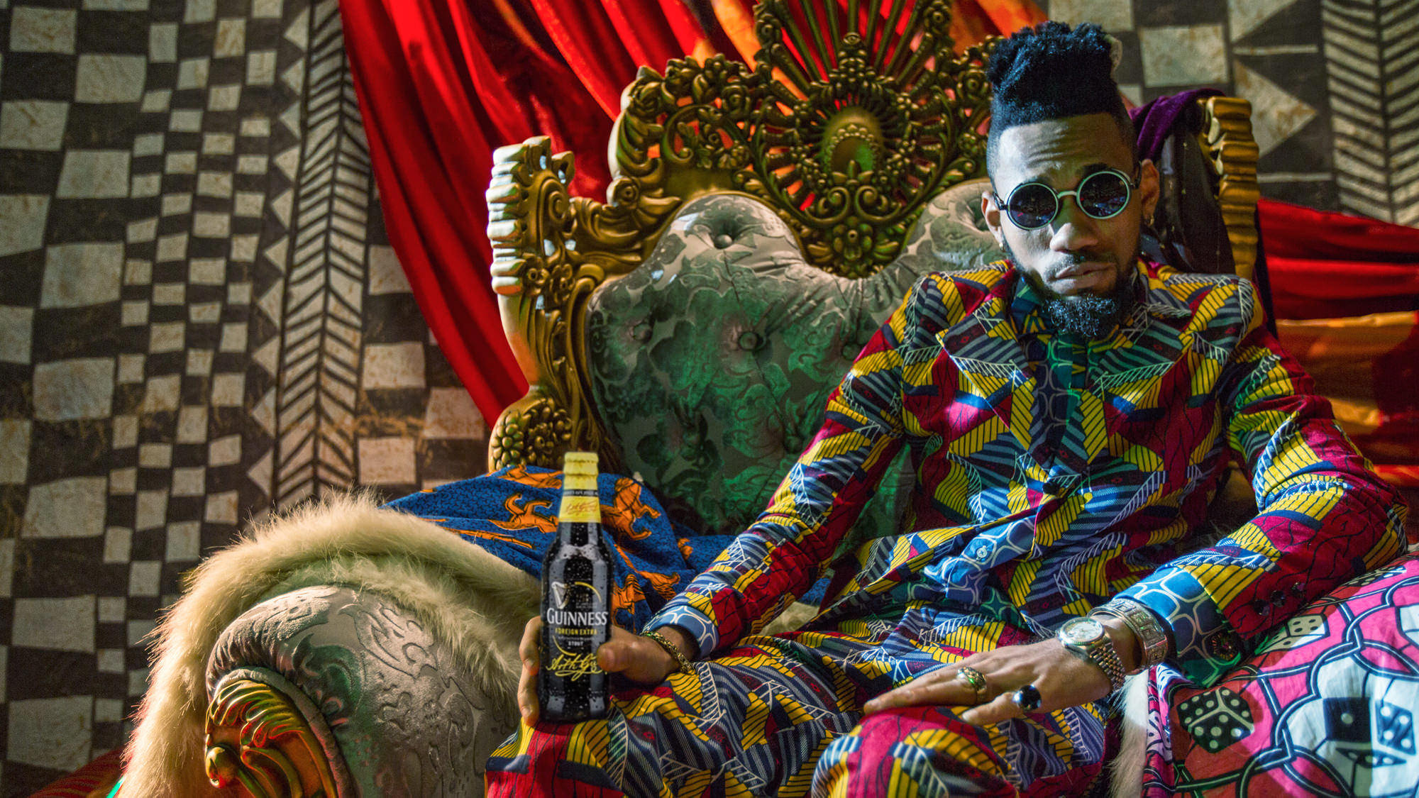 Campaign image of Nigerian Rapper Phyno with a Guinness bottle for Guinness Campaign #MadeOfBlack Made of Black | Michelle Wastie Photography