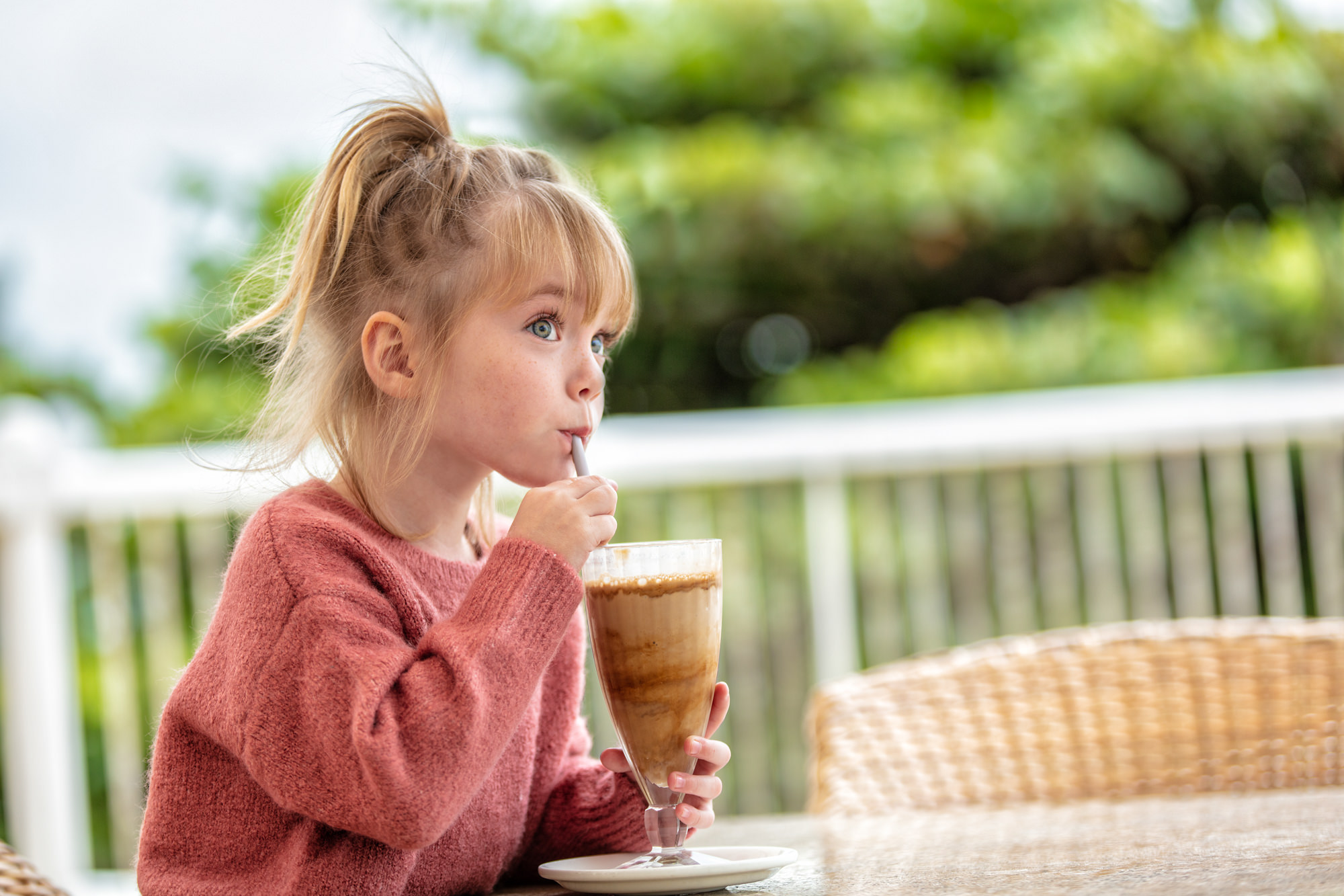 Image of girl drinking a milkshake at the Beverly Hills Hotel in uMhlanga Rocks, Durban for  Tsogo Sun's Image Library & Content Library by Michelle Wastie Photography