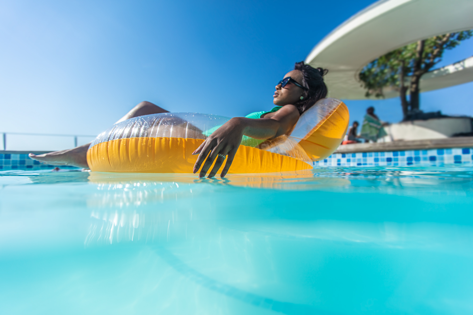 Image of woman in a pool for Tsogo Sun's Image Library & Content Library by Michelle Wastie Photography