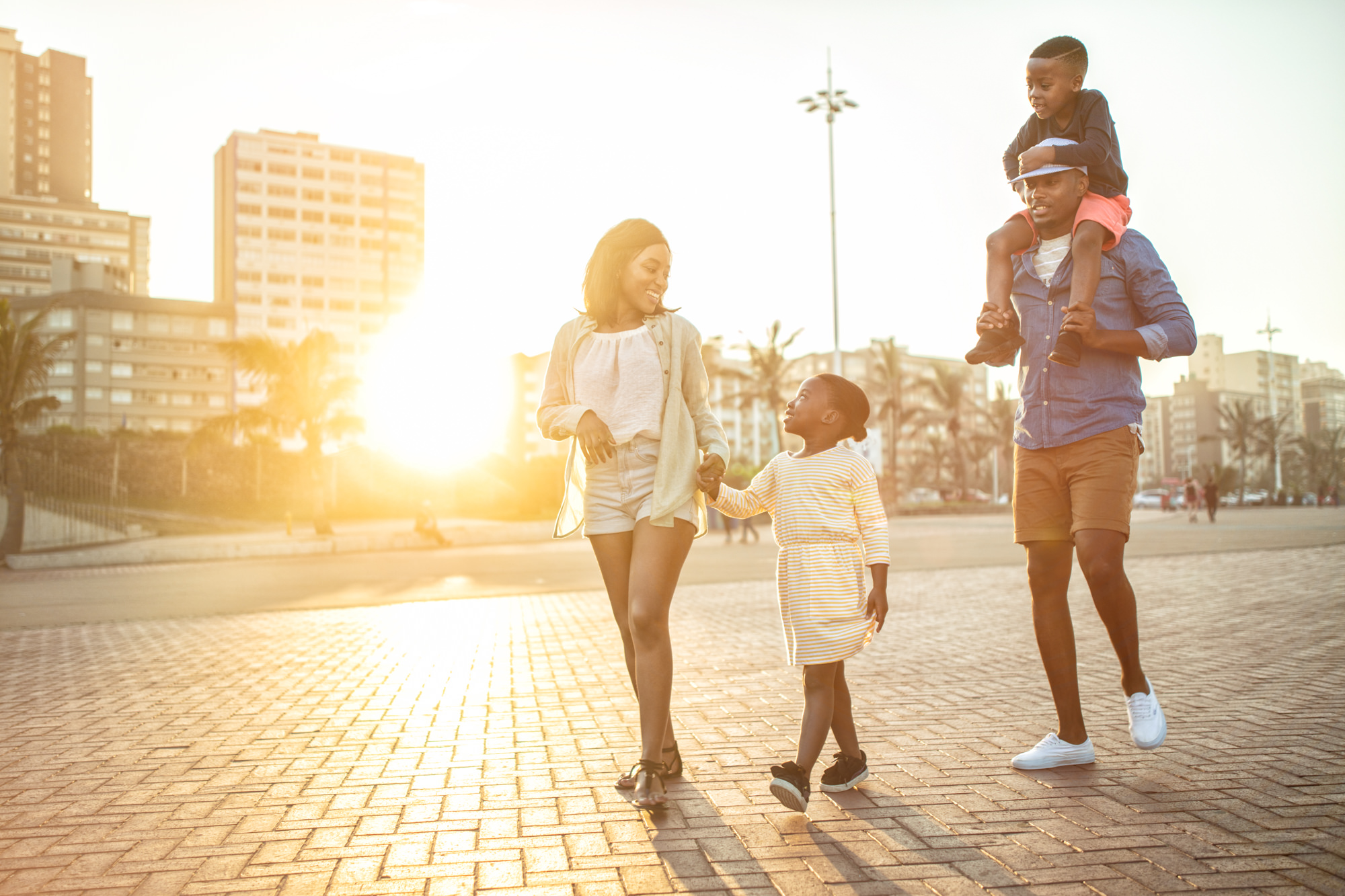 Image of family walking on the promenade in Durban for Tsogo Sun's Image Library & Content Library by Michelle Wastie Photography