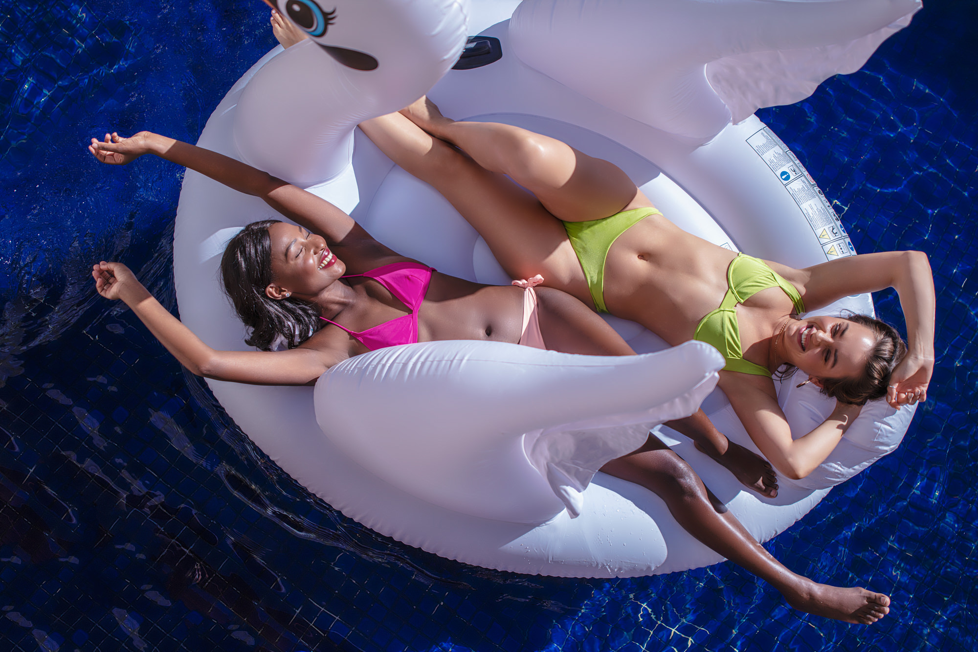 Image of girl friends having fun in the Southern Sun The Cullinan Hotel pool for Tsogo Sun's Image Library & Content Library by Michelle Wastie Photography