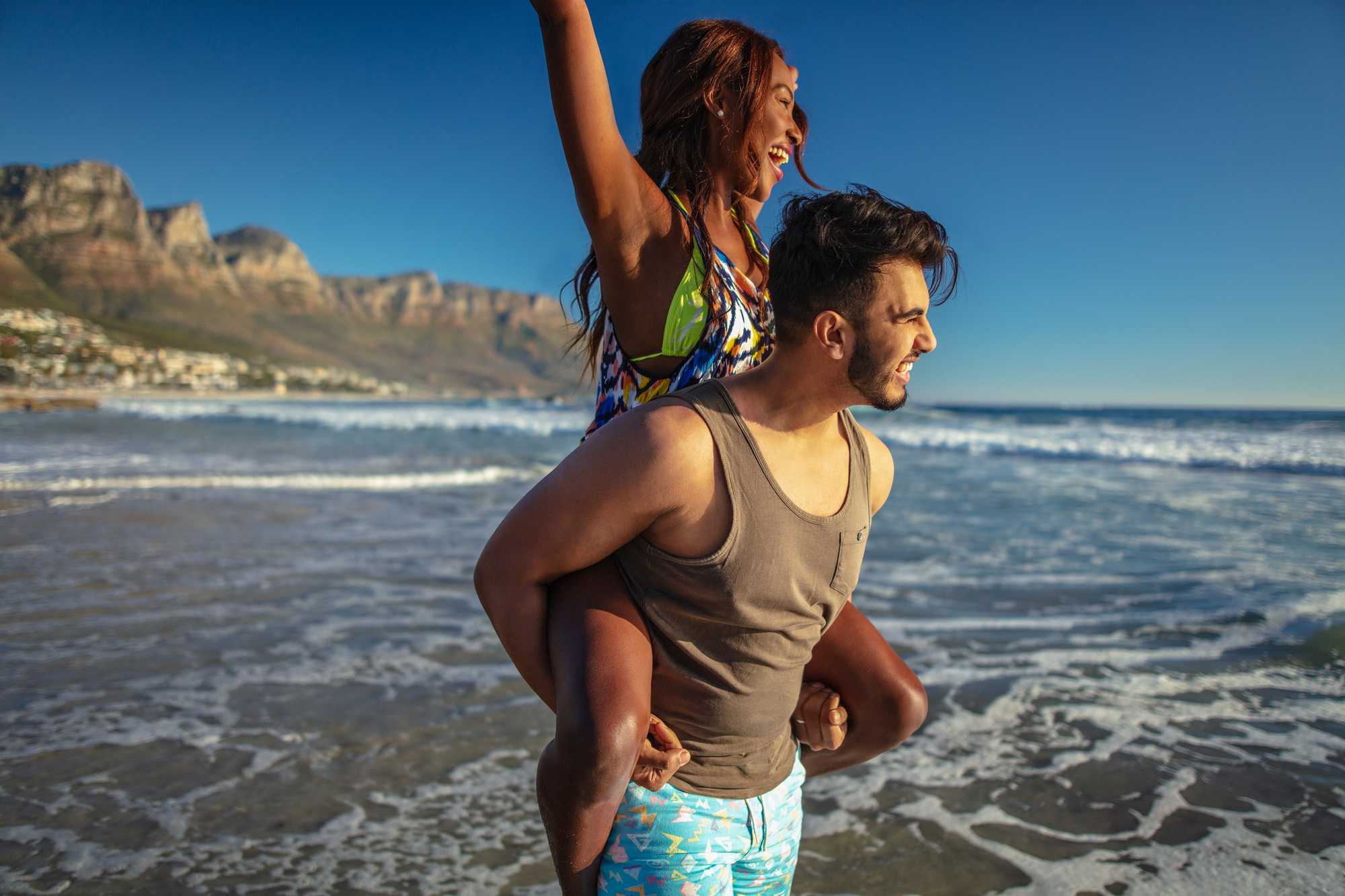 Image of couple having fun on the beach in Cape Town for Tsogo Sun's Image Library & Content Library by Michelle Wastie Photography