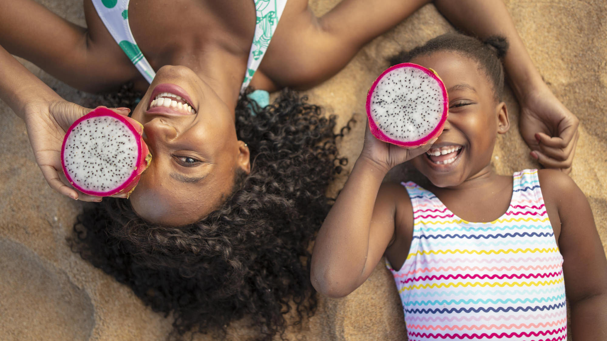 Image of mother and daughter having fun on the beach for Tsogo Sun's Image Library & Content Library by Michelle Wastie Photography