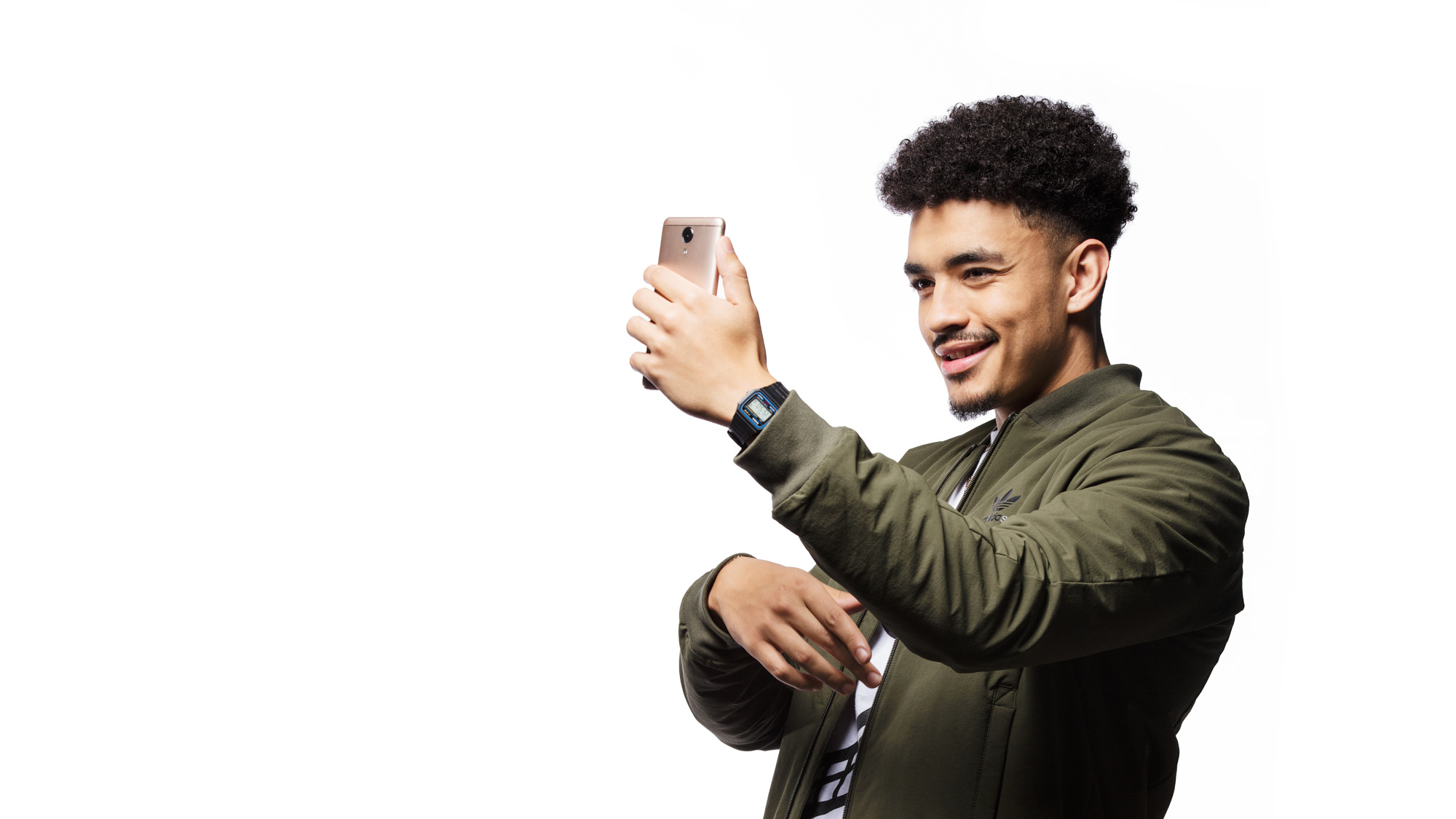 Shane Eagle holding a Mobicel mobile phone for the Mobicel Going Places Commercial which was directed by Michelle Wastie Photography