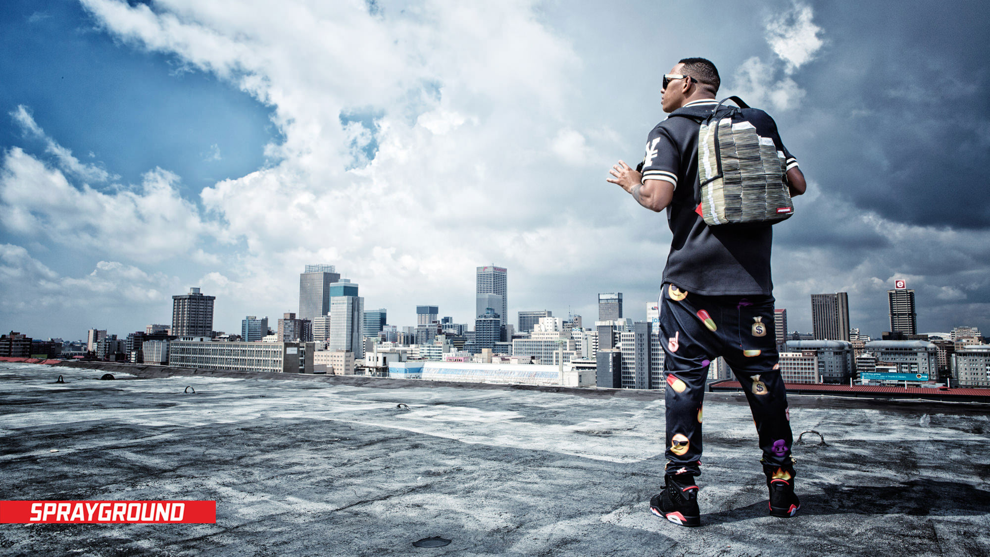 Image of Da L.E.S on Johannesburg CBD rooftop for Sprayground's Africa Launch by Michelle Wastie Photography.