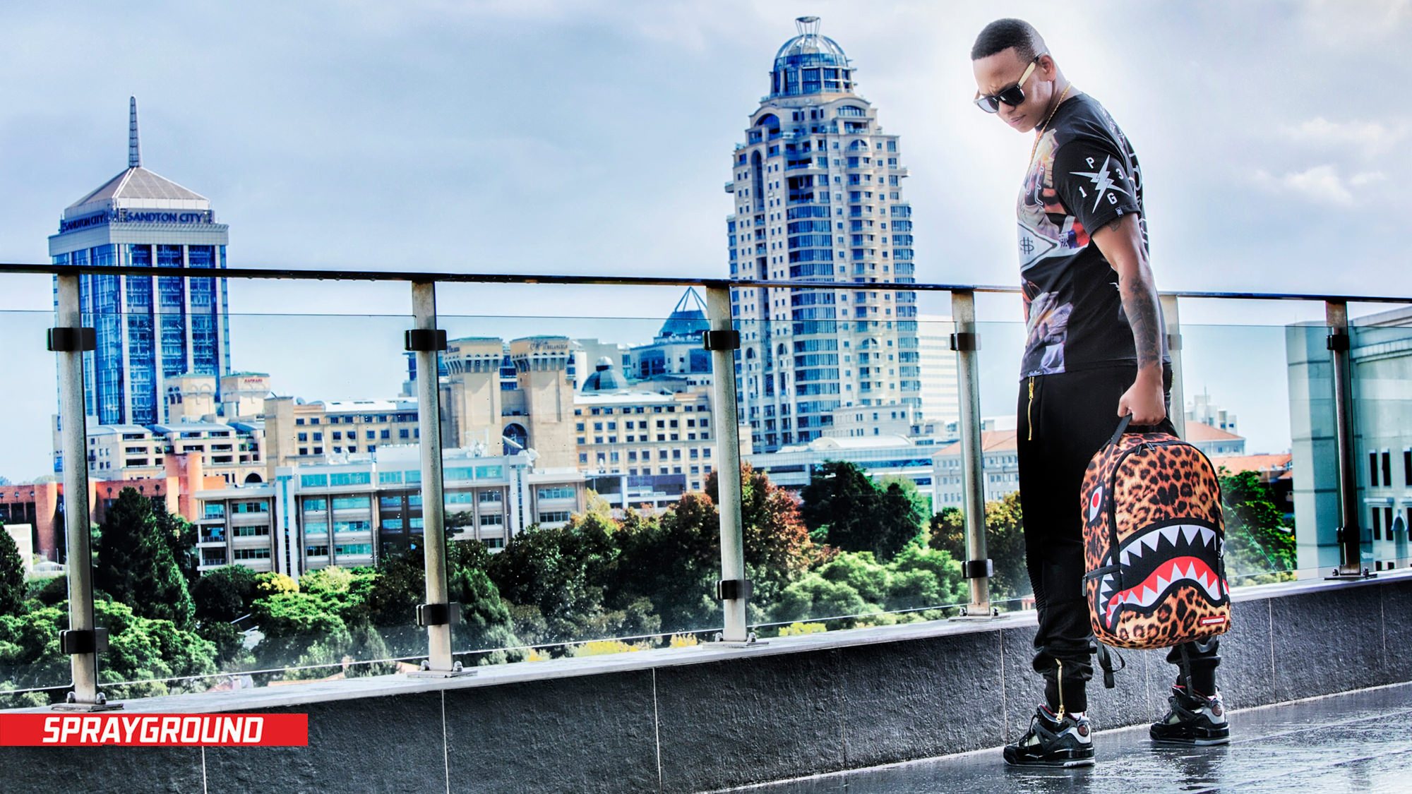 Image of Da L.E.S on Sandton Rooftop for Sprayground's Africa Launch by Michelle Wastie Photography.