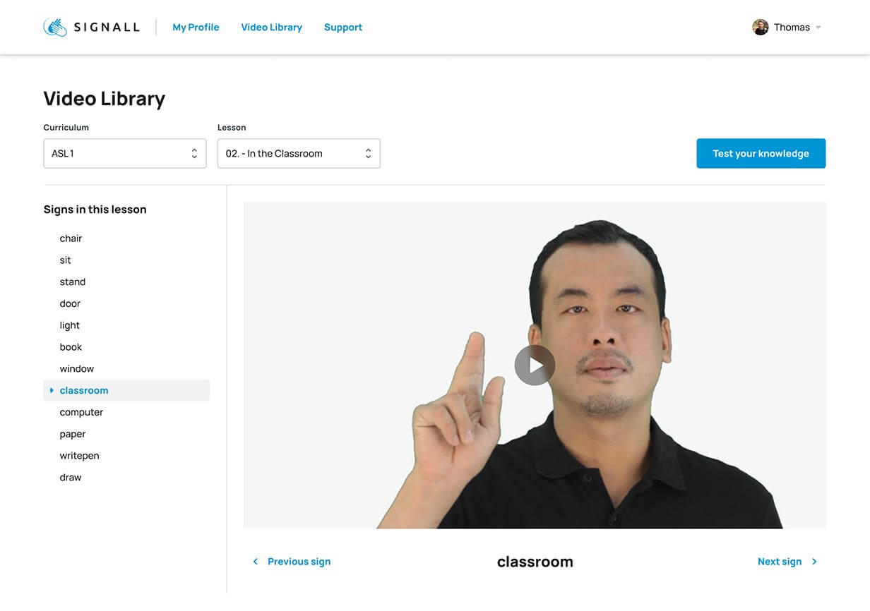 SignAll Online ASL video library screenshot. An instructor shows a sign