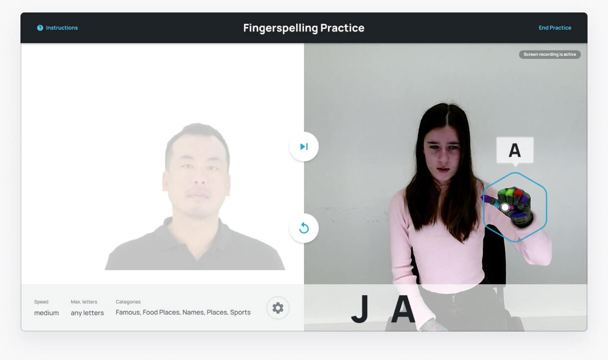 "Split screen. On the left an ASL instructor shows a handshape. On the right a student repeats. SignAll Learn lab identifies his handshape to represent the letter ""N"""