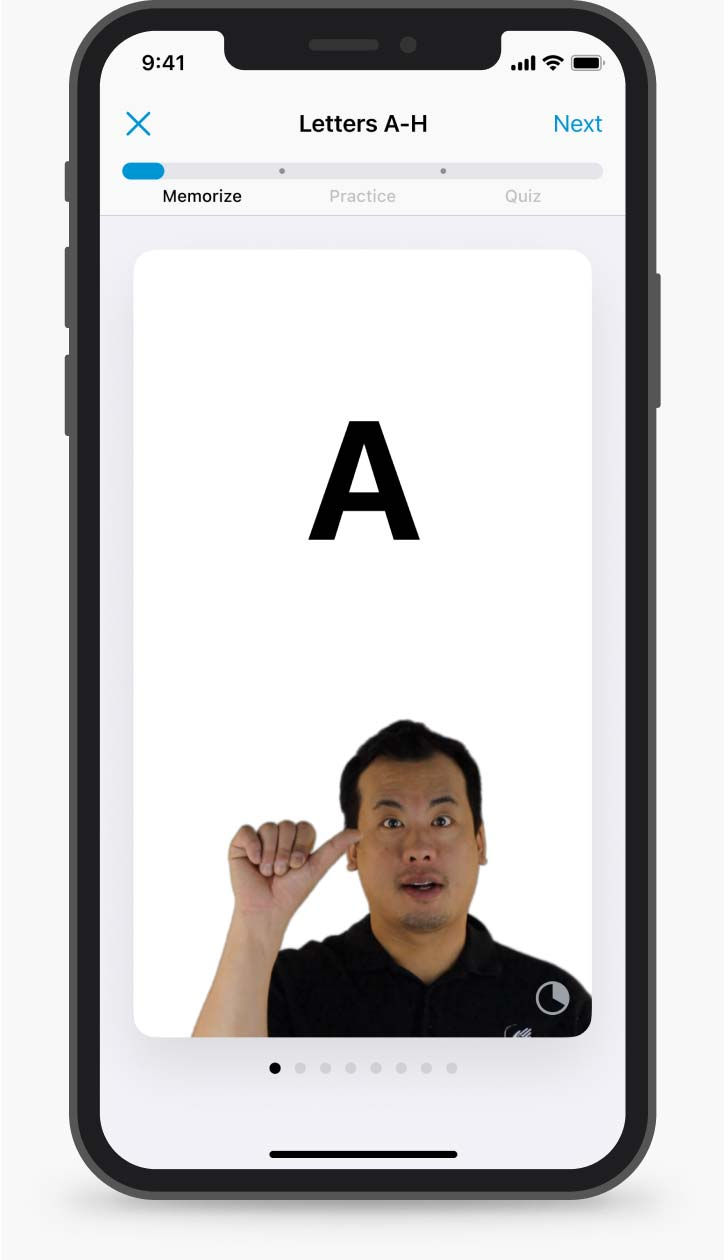 """A mobile phone screen with an example of a unit: an ASL instructor shows the letter """"A"""""""