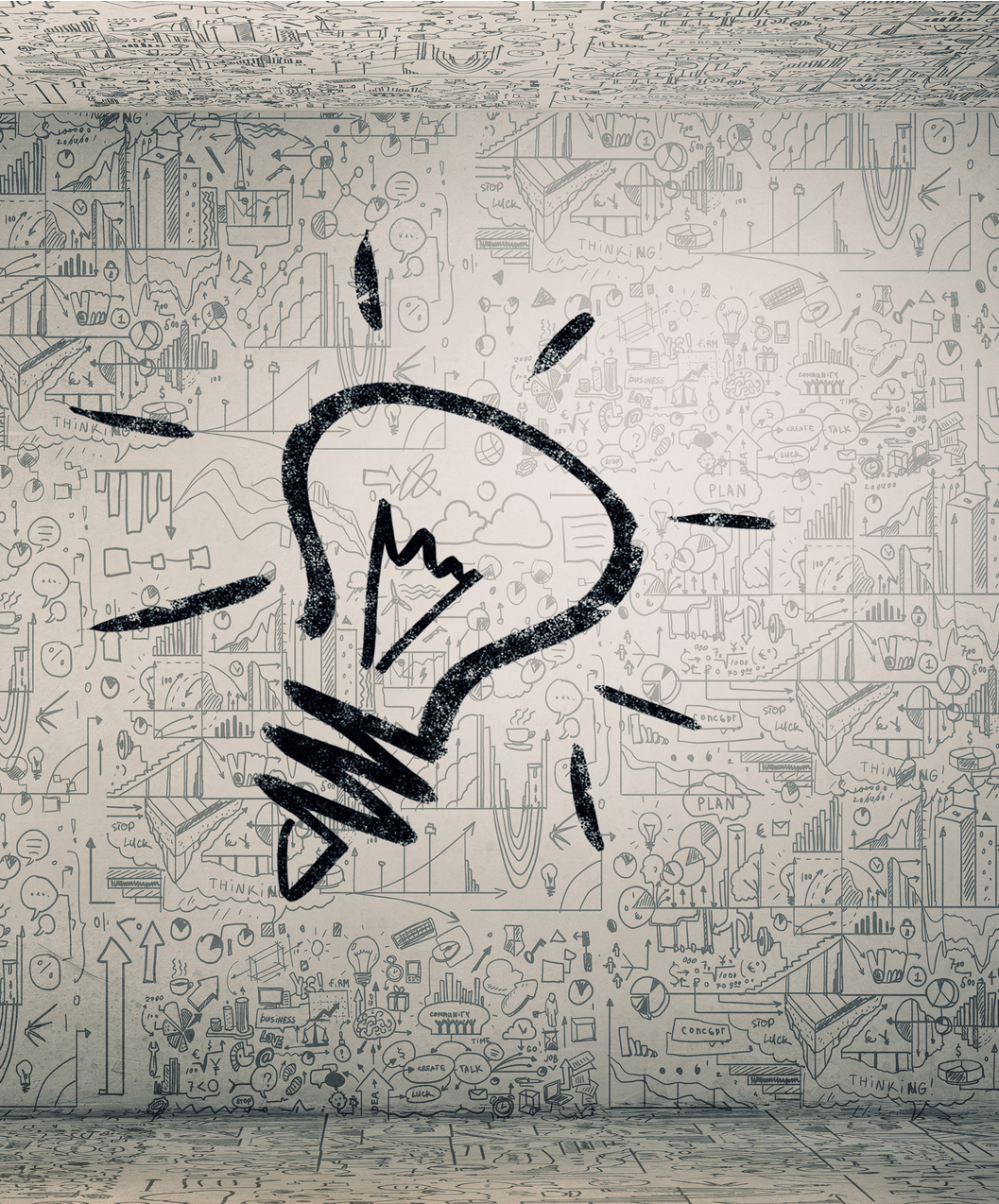 This image is a lightbulb that conveys ideas and shows scribbles on a wall behind ist
