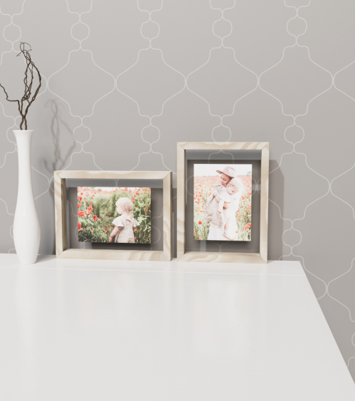 Framed pictures on table