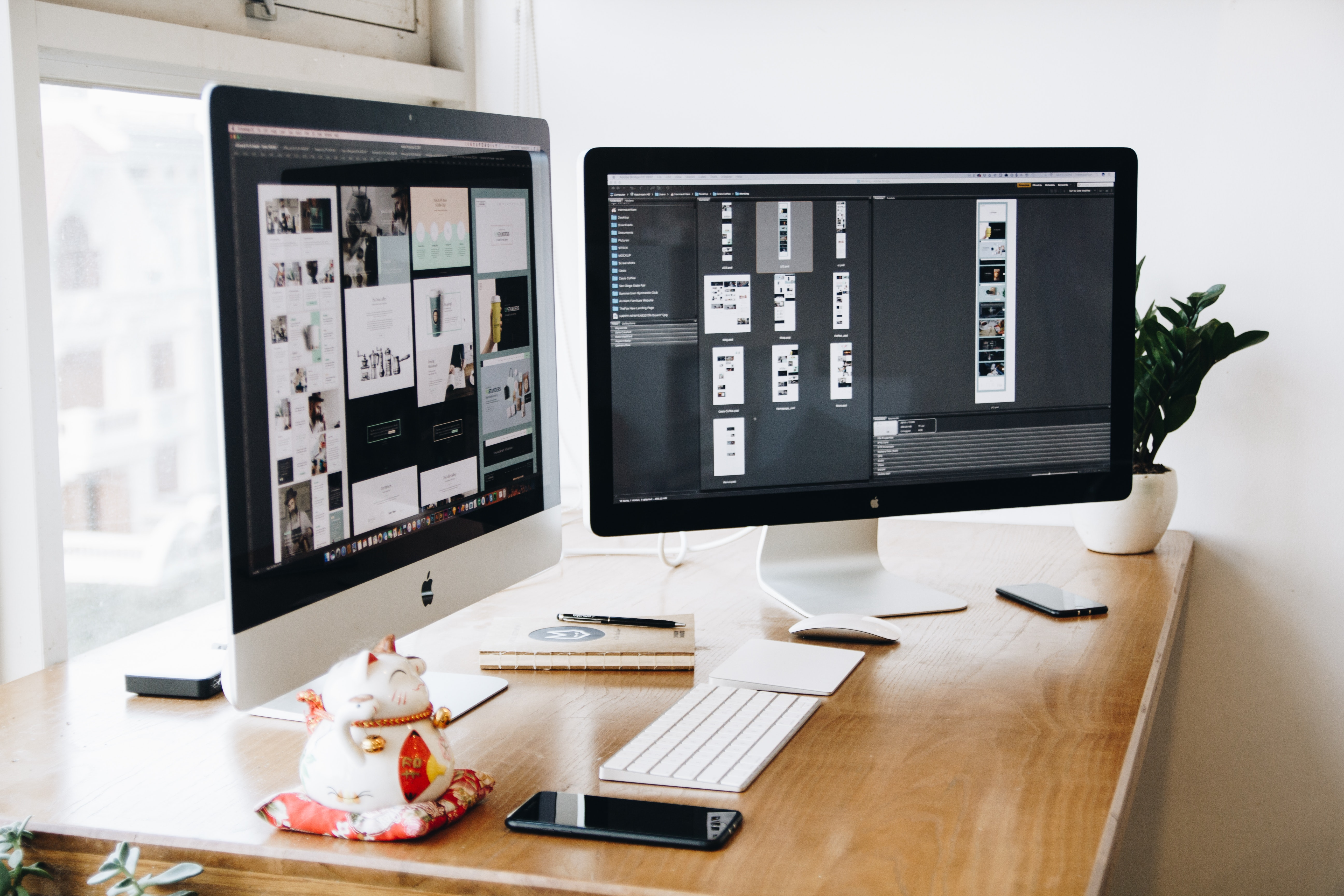 Image of two Imac's on a desk within a creative workspace.