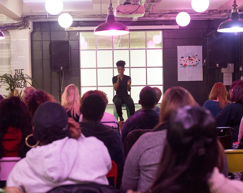 Image of Creative Champs founder Kei Maye delivering a talk to an audience.