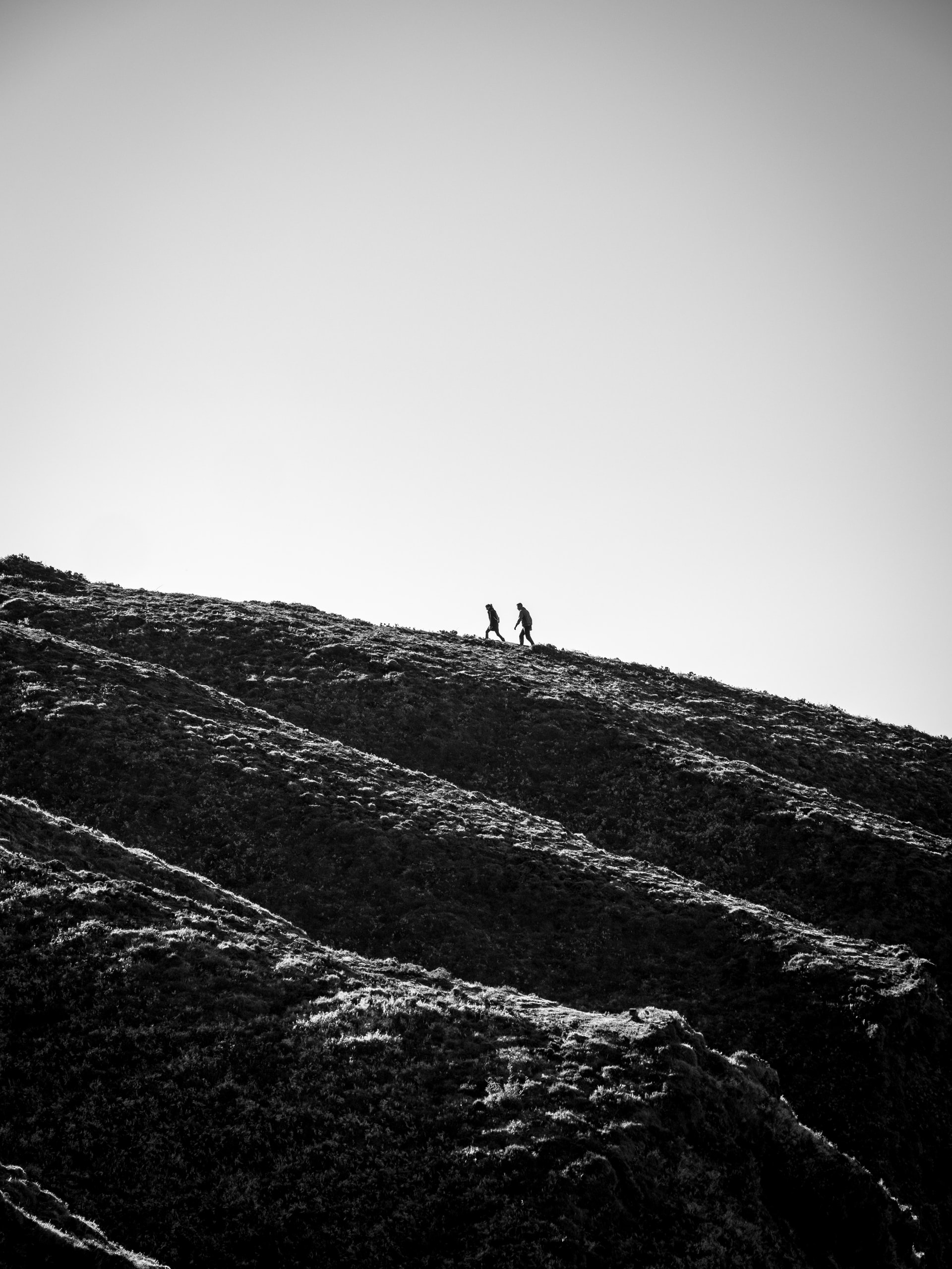 People hiking on hill