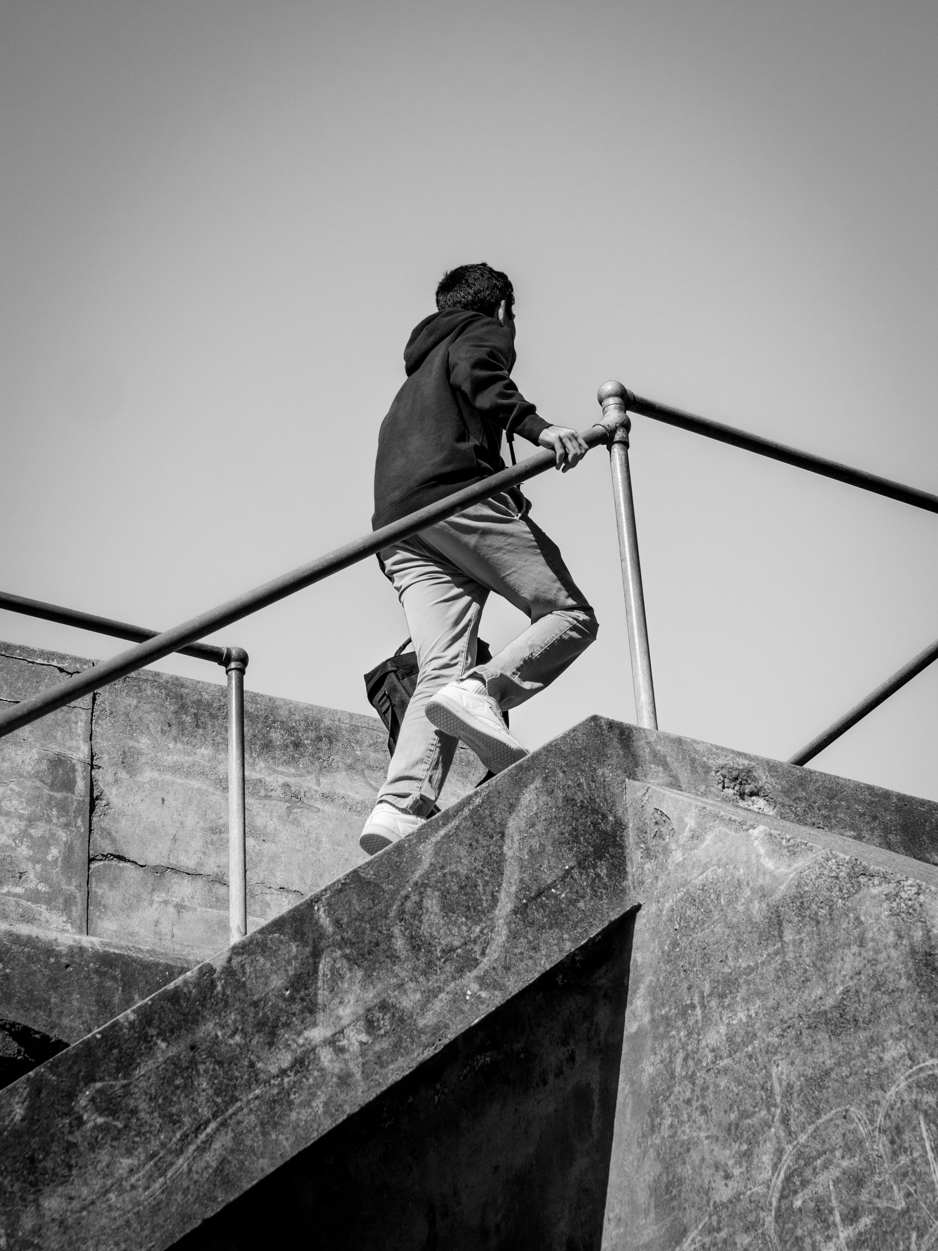 Man climbing concrete stairs
