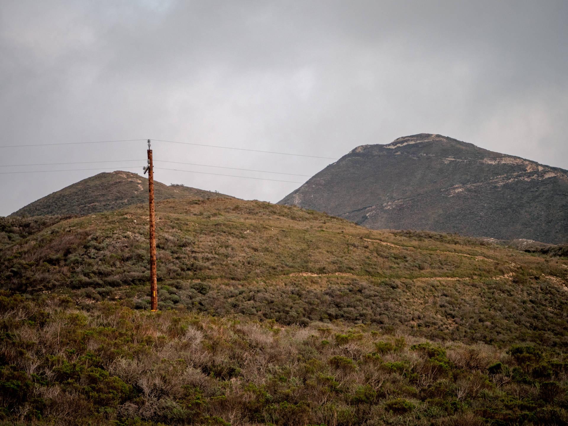 Telephone Pole on a Mountain