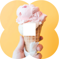 A person's hand holding a cone with a large scoop of pink ice cream, possibly strawberry flavoured.