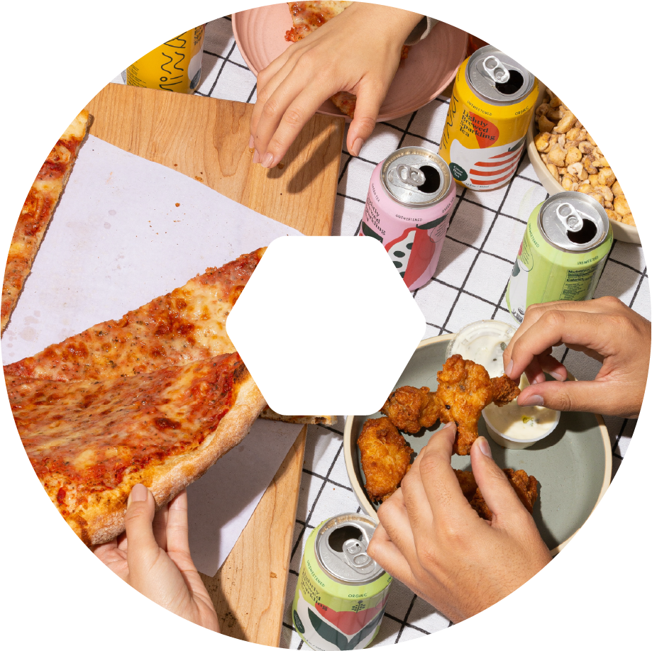 A close-up of a group of people sharing pepperoni pizza and different soft drinks.