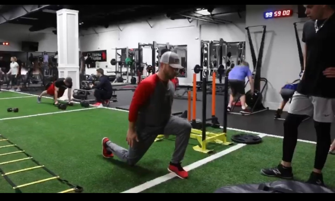 Trainer demonstrating lunges