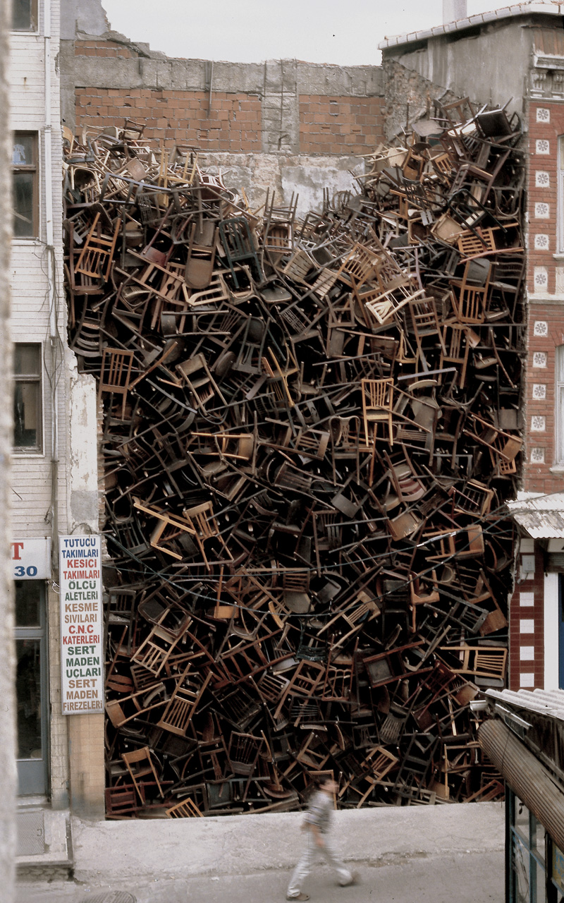 Doris Salcedo – Untitled, 2003, 1,550 wooden chairs, approx. 10.1 × 6.1 × 6.1 m (33 × 20 × 20 ft.), 8th International Istanbul Biennial, Istanbul, 2003