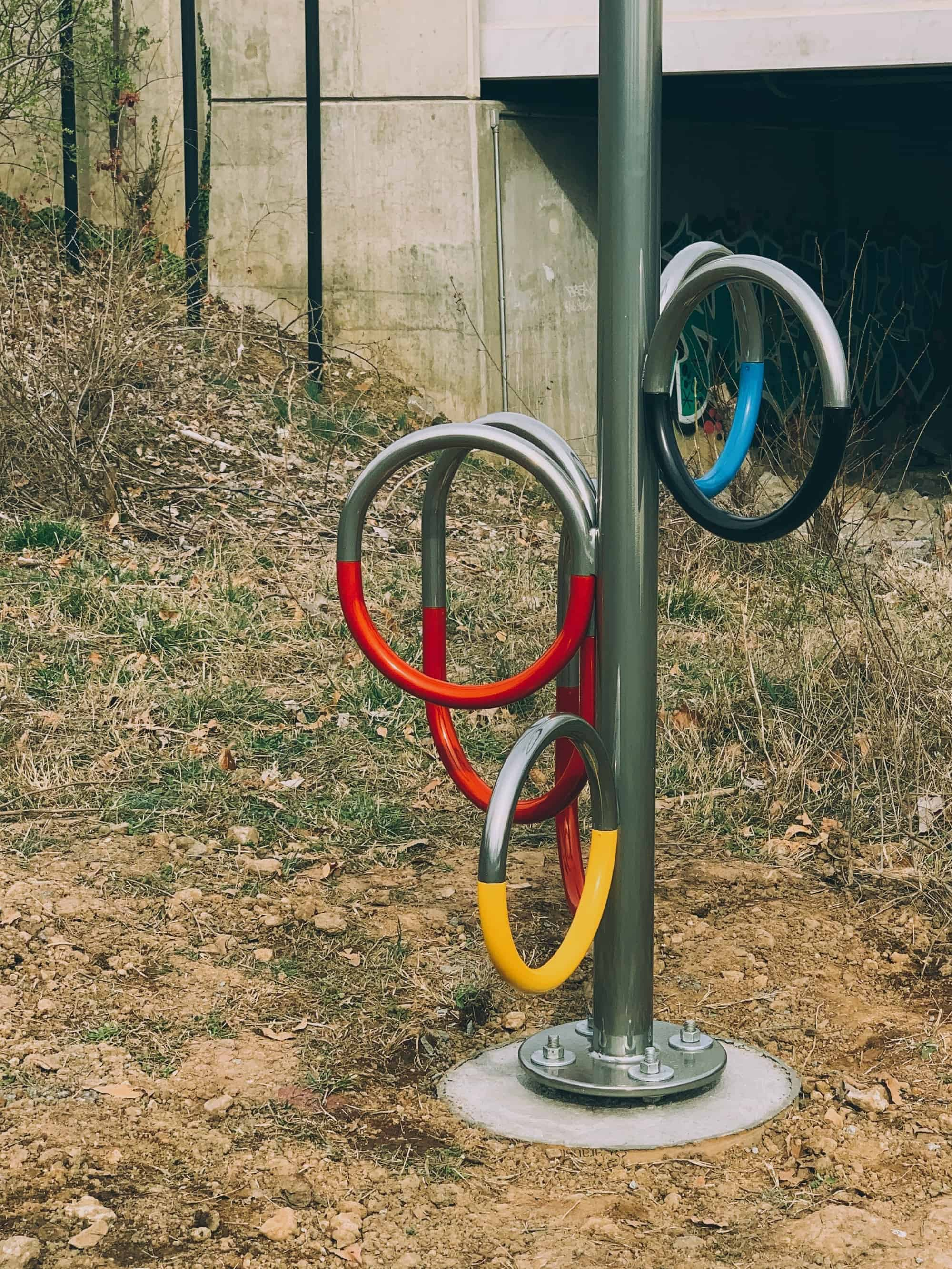 Detail of Marvin Gaye Park location of High Water Mark showing footing assembly, chrome paint, and color-coded flags.