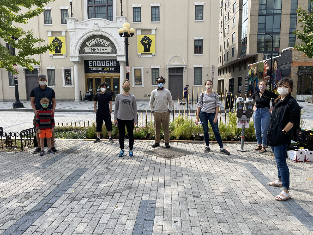 Curry Hackett and LAB team members standing on T Street NW sidewalk during DiasFlora event.