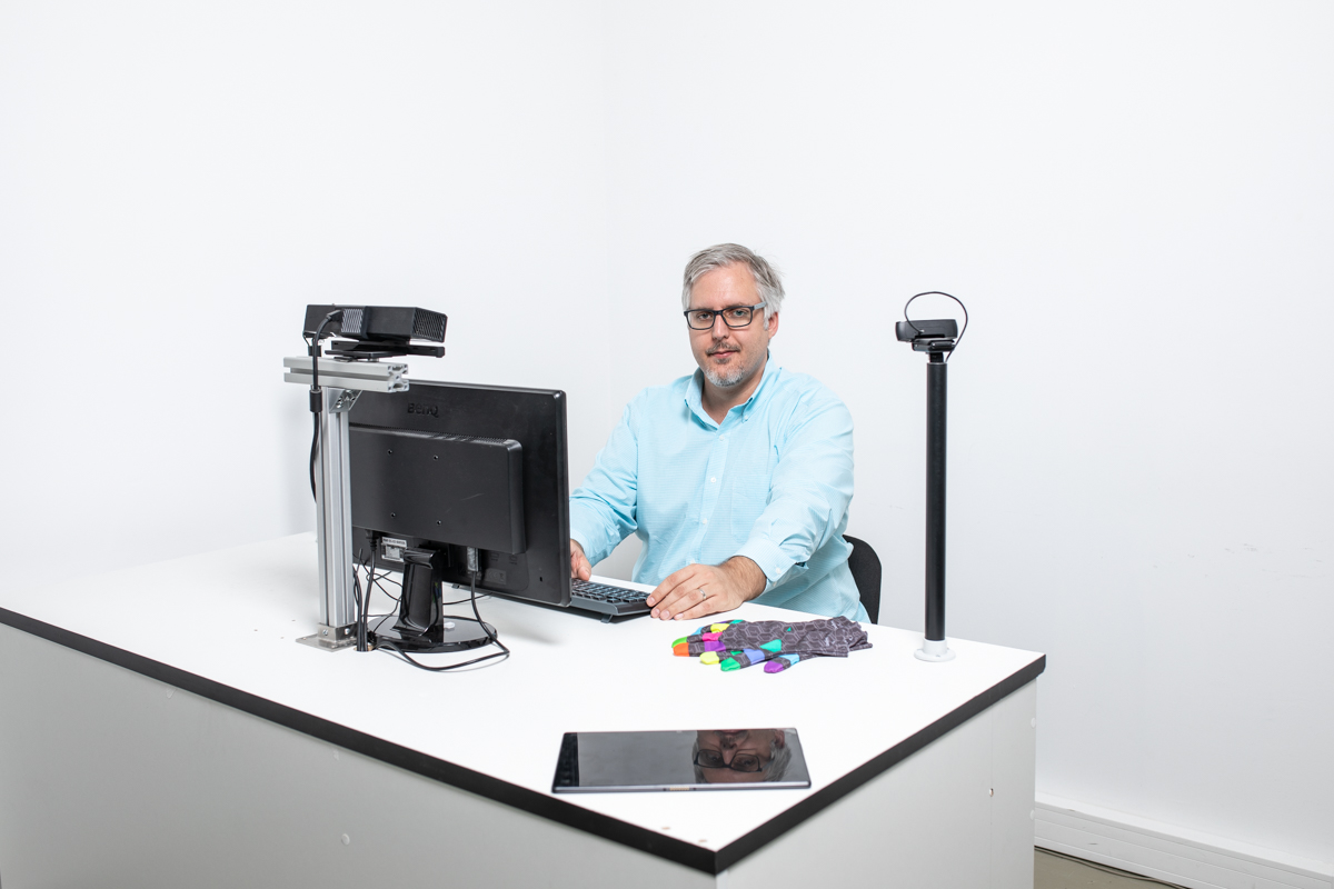 Zsolt Robotka at a SignAll Learn Lab workstation