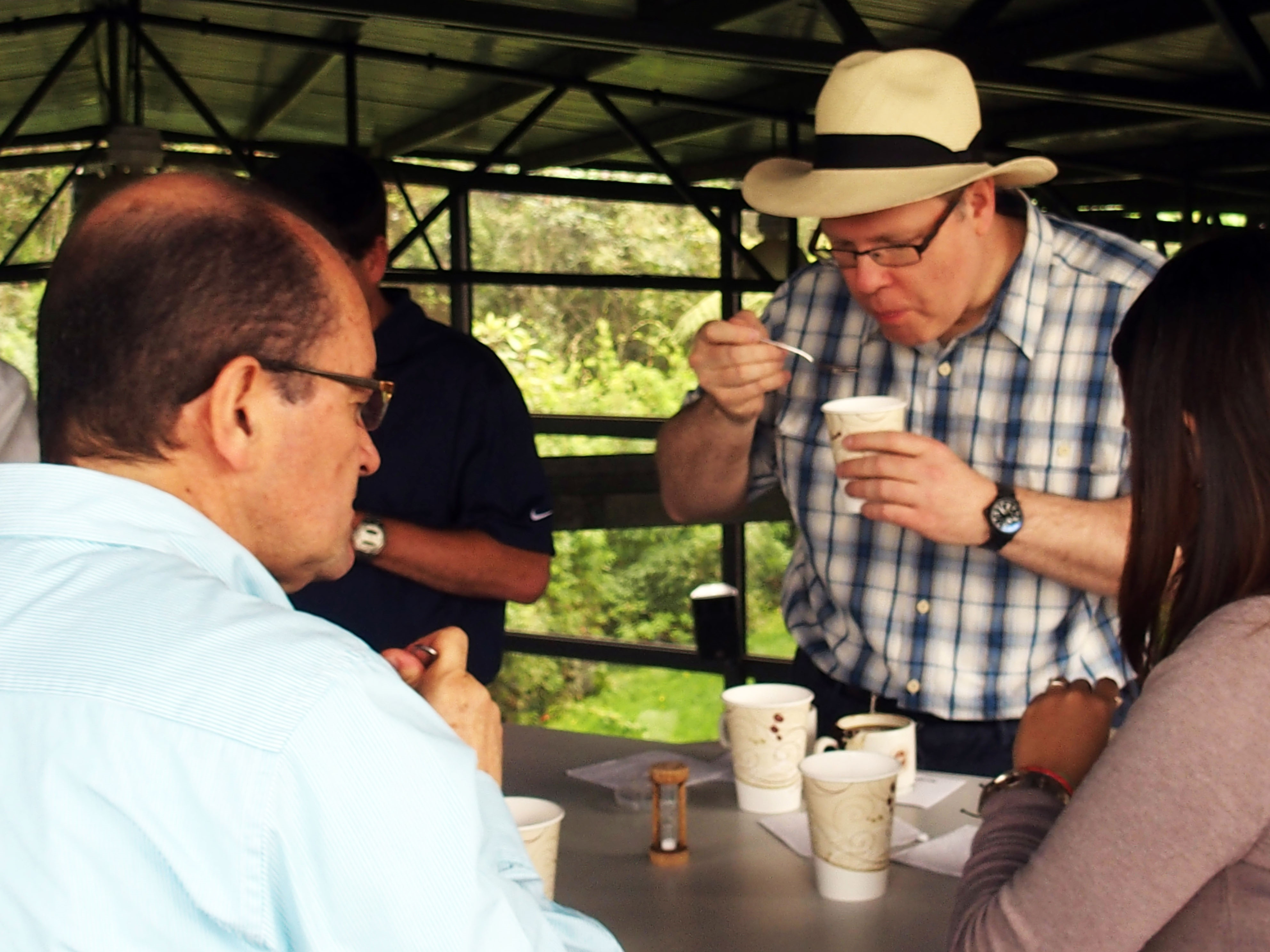 Cupping coffee at origin