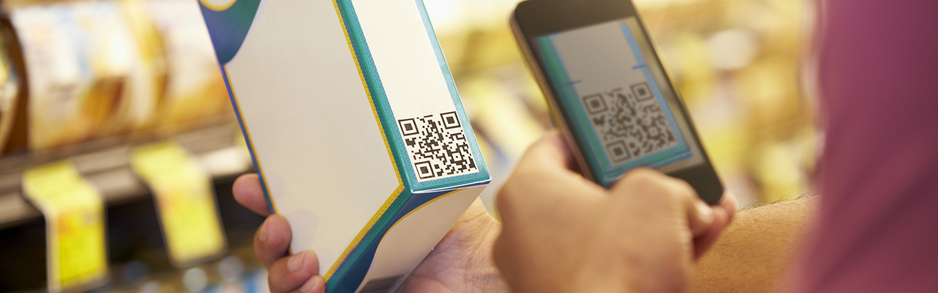 Scanning a packaging barcode to detect food fraud