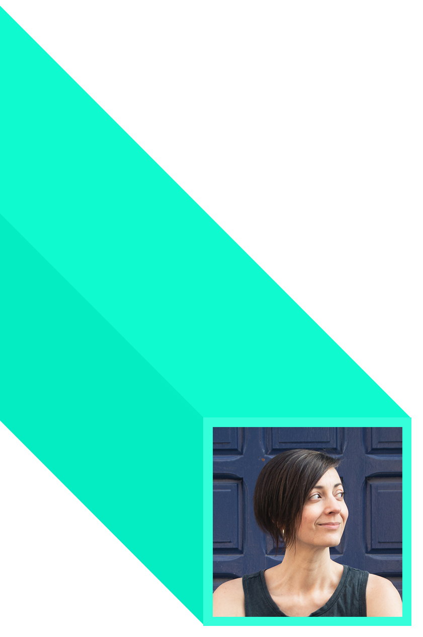 A picture of Kelly's face, in a teal box with a long, geometric shadow. She's looking off to the right with a mischievous, yet adorable look on her face.