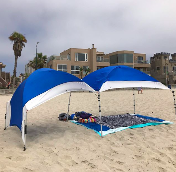 Two shade tents joined together
