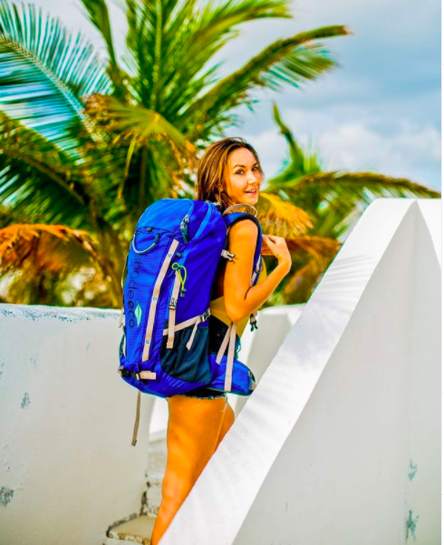 Girl model on stairs with backpack