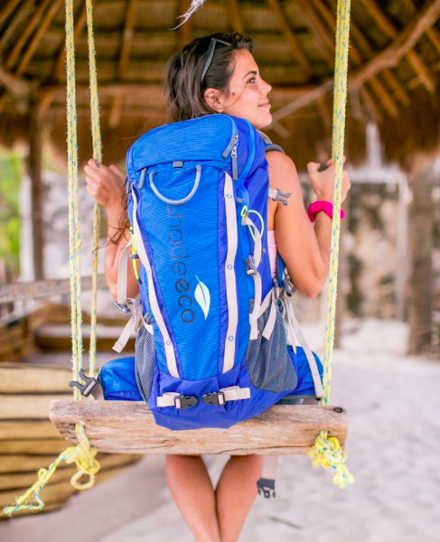 Model with backpack on swing