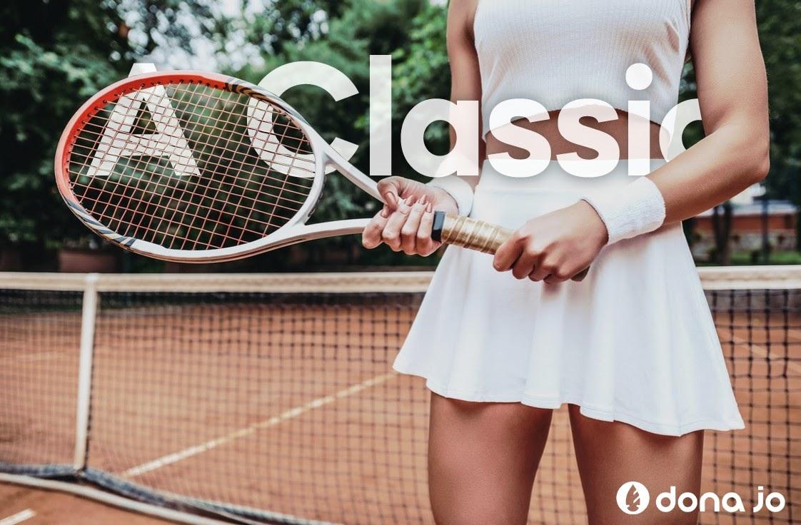 women holding a tennis racket