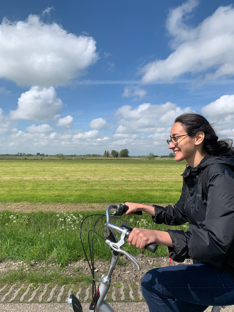 Marie riding a bicycle in a field