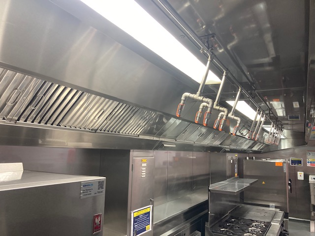 clean commercial kitchen with stainless steel complying to the standards
