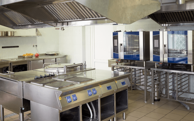 commercial kitchen with stainless steel equipment with blue trim