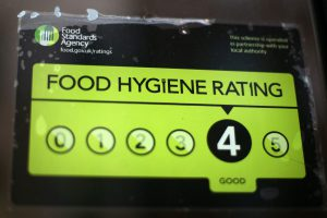 LONDON, ENGLAND - FEBRUARY 09: A Food Standards Agency rating certificate is pictured in the window of a restaurant on February 9, 2015 in London, England. Claims have been made that some restaurants are ignoring food hygiene standards ratings. (Photo by Carl Court/Getty Images)