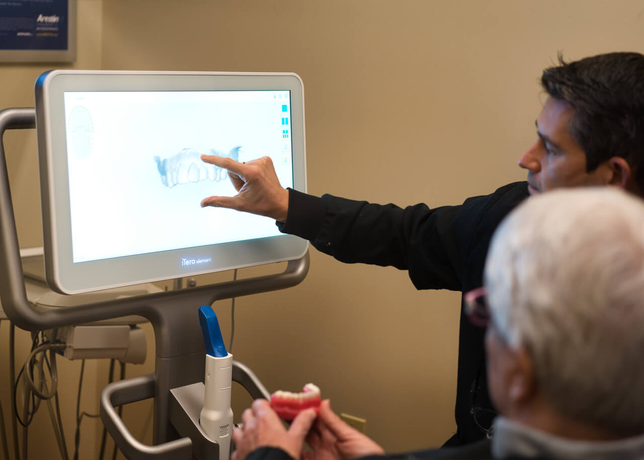 Dr. Mark speaking to a patient about jaw joint treatment.