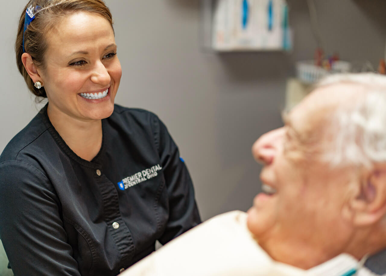 Dr Megan Kottman answering questions from a patient