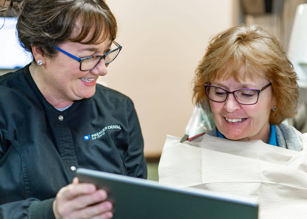 a patient learns about their options for dental crowns